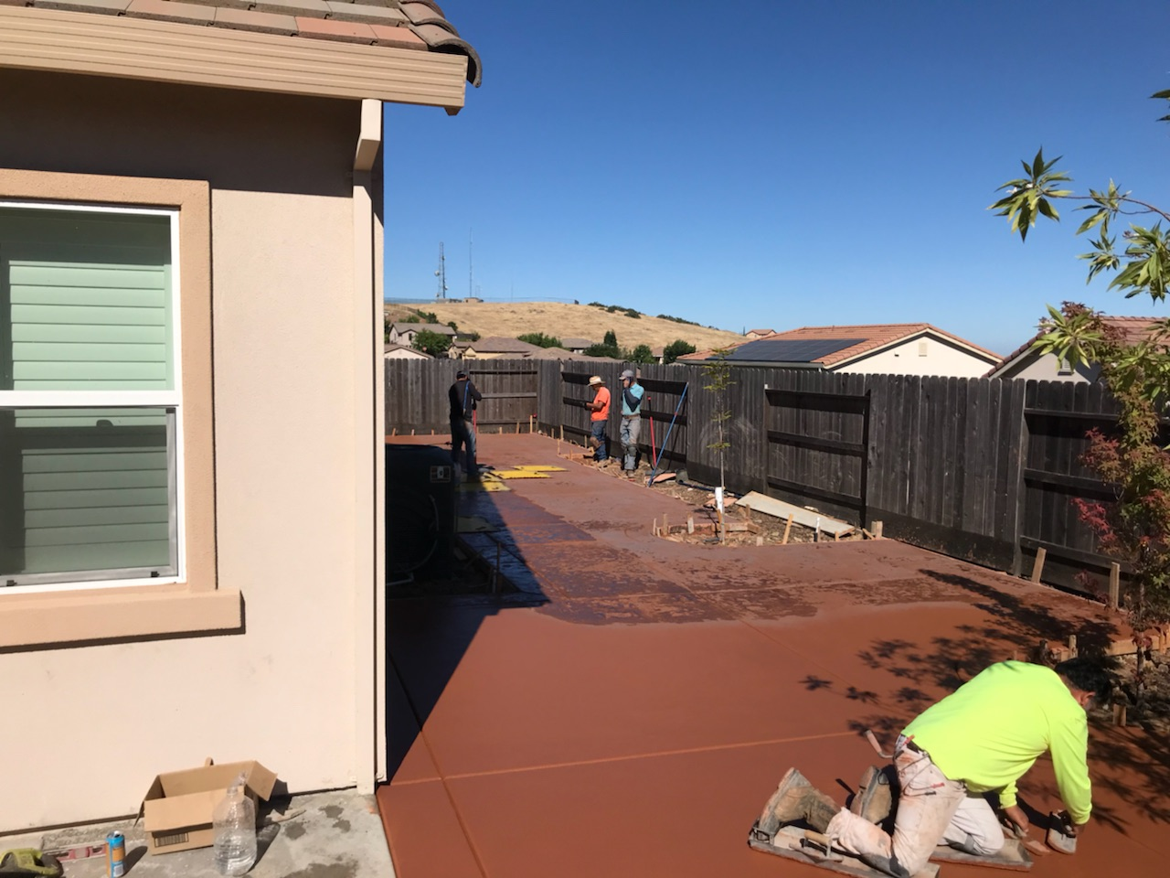 The photo shows the finished colored concrete work in Chino Hills.